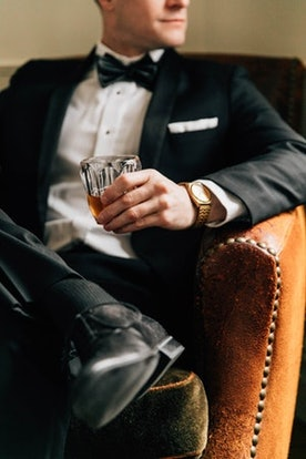 Man in tux having a drink