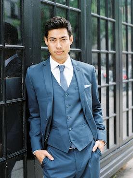 Man in suit posing outside