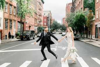 Groom in black peak lapel tux with bride