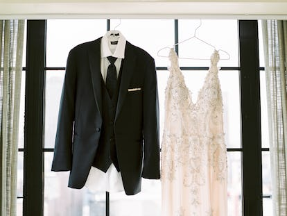Black Peak Lapel Tuxedo next to wedding dress