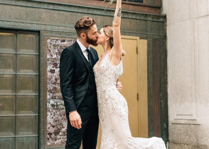 Bride with groom wearing Generation Tux Black Peak Lapel Tuxedo
