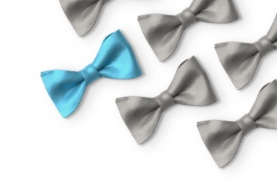Gray bow ties with one blue bow tie laying in a grid.