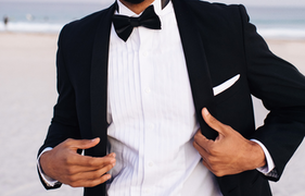 Groom wearing tux on the beach
