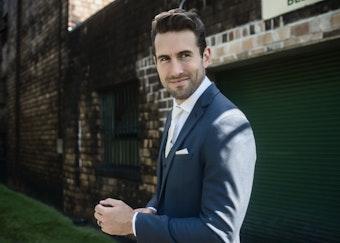 Groom wearing Slate Blue Suit