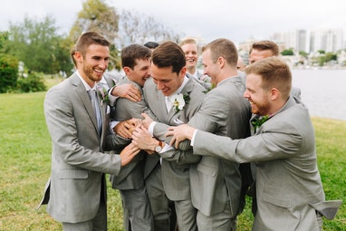 Groomsmen roughing up the groom before the big moment
