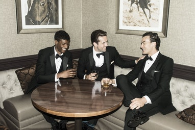 Groom and groomsmen having a bourbon together
