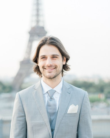 Groom in gray at a French destination wedding