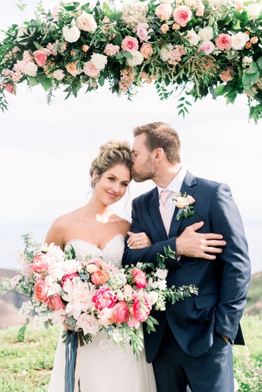 Newly Weds under flower alter