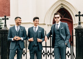 Groomsmen out front of church.