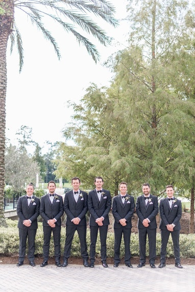 Wedding party with black tuxedos
