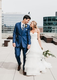 Bride with groom wearing Mystic blue suit rental