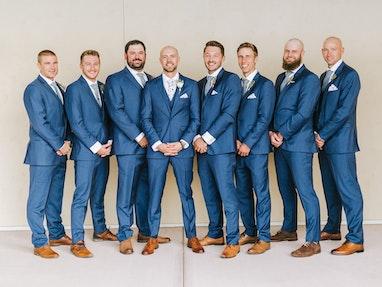Groom and groomsmen dressed in blue