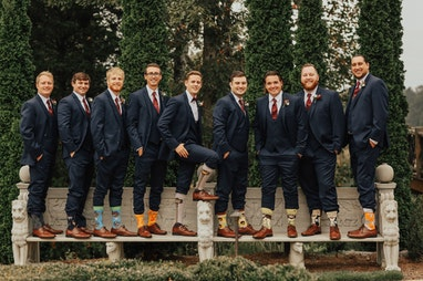 Groom and groomsmen showing their socks off