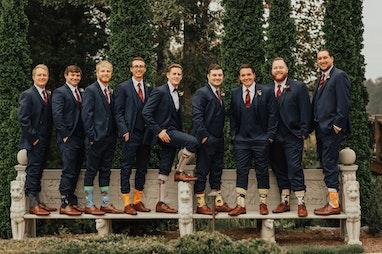 Groom and groomsmen showing their socks off
