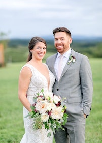 Portrait of newly weds outside on a lawn