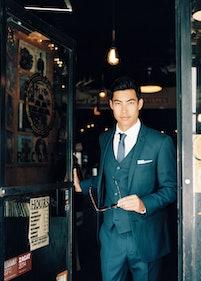 Sharp dressed man leaving store.