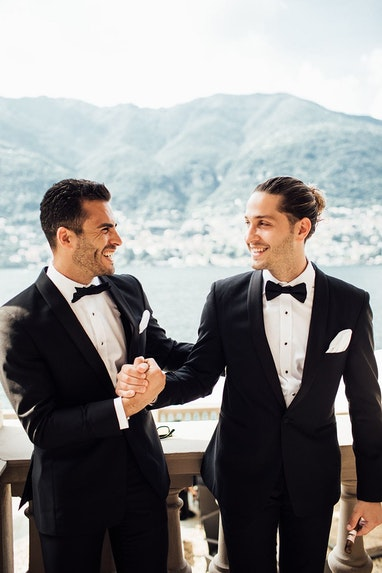 Groom shaking hands with the best man