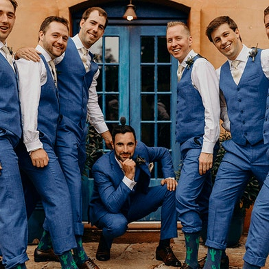 groom and groomsmen at wedding wearing mystic blue suit rentals