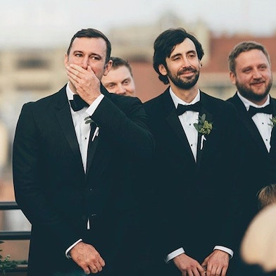 Groom and groomsmen waiting at the alter wear black tux rentals