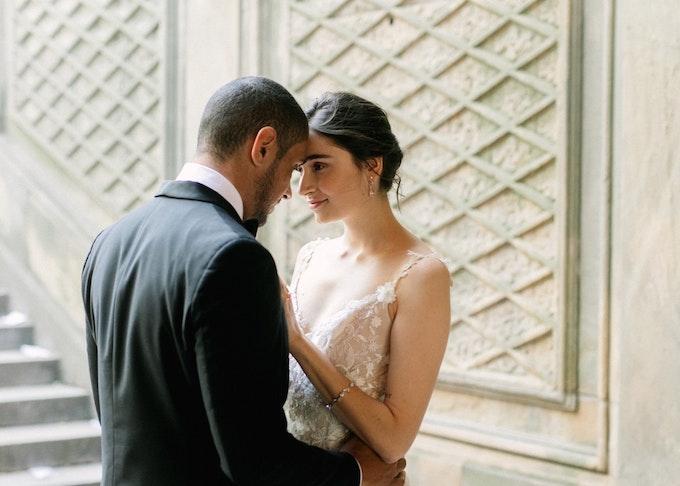 Groom in Black Men's Wedding Suit with Bride