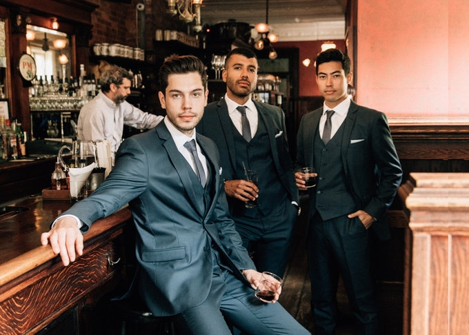 3 guys in a bar wearing notch lapel suit rentals