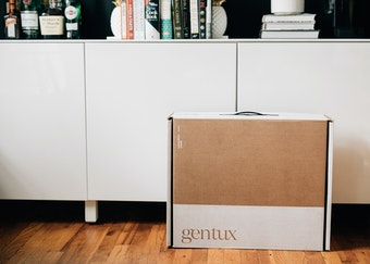 photo of generation tux delivery box next to a while console table