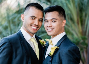 wedding picture of young gay couple wearing tuxedos from generation tux