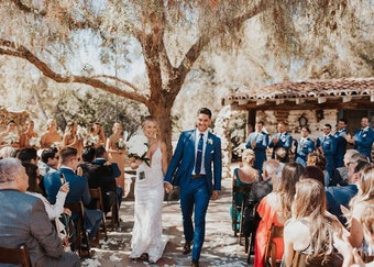 photo of a groom and bride walking down the aisle during an outdoor wedding in austin