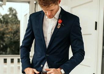 photo of red haired man wearing a navy suit