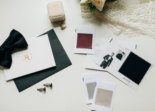 photo of tuxedo color swatches, a bowtie, and a letter from generation tux