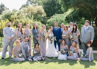 wedding photo of bridesmaids, groomsmen, and bride and groom in neutral grey colors