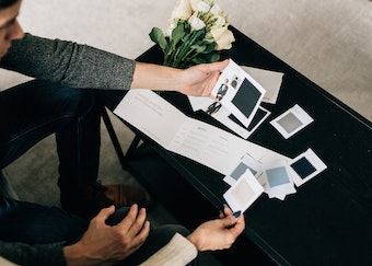 photo of a man and a woman comparing tuxedo swatches before a wedding