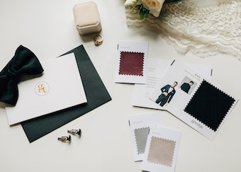 photo of tuxedo color swatches next to a black bowtie, cufflinks, and card