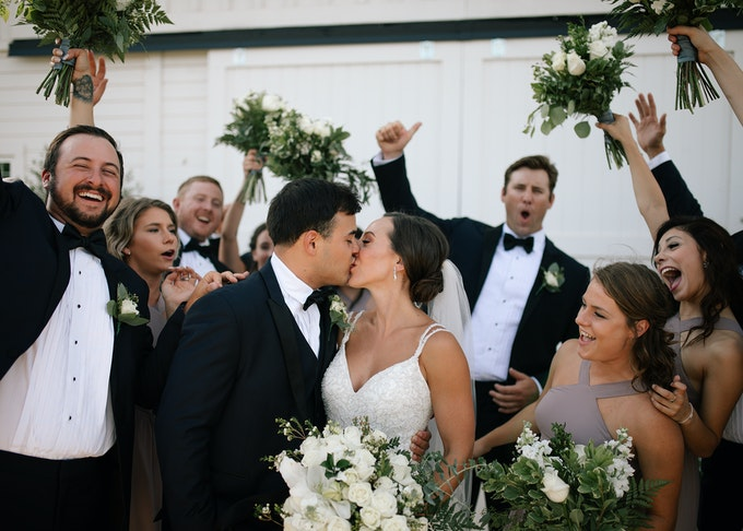 photo of husband and bride kissing during a wedding ceremony