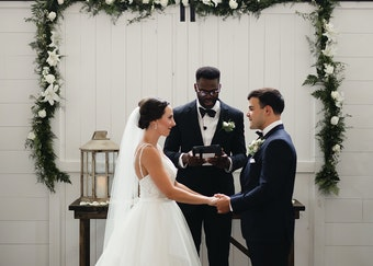 photo of a bride and groom holding hands during a wedding ceremony saying vows