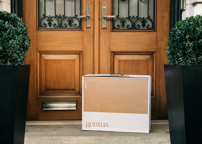 photo of a generation tux delivery box on a front doorstep on the ground