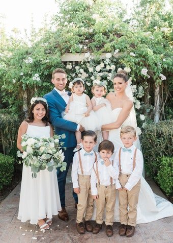 photo of a groom and bride with six children and toddlers