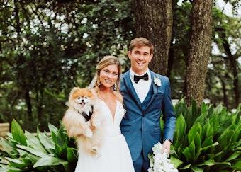 Happy wedding couple wearing a blue Menguin tuxedo