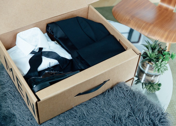 black Menguin wedding tux with a real black bowtie laid in its box