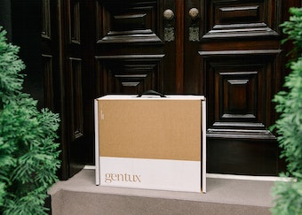 generation tux box sits on the doorstep of a house with black doors