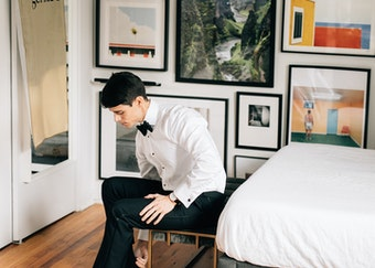 man getting ready wearing a generation tux tuxedo