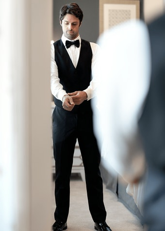 Groom Trying on Suit