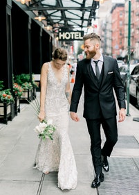 Bride and Groom in Generation Tux Black Tuxedo