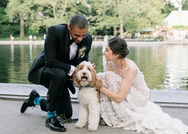Groom in Black Shawl Lapel Tuxedo with Bride and dog