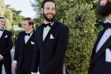 Groomsman in Generation Tux Black Tuxedo