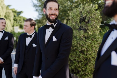 Groomsman in Generation Tux Black Tuxedo