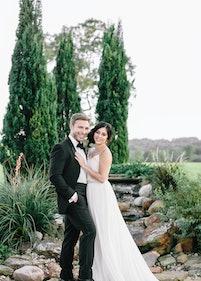 Groom in Black Tuxedo with Bride