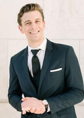 Happy Groom in Black Generation Tux Suit
