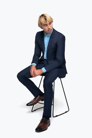 Ian Crane in Generation Tux Suit sitting