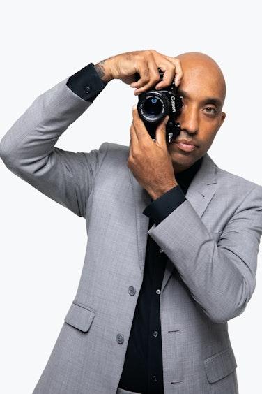 Atiba Jefferson in Generation Tux Suit taking photo